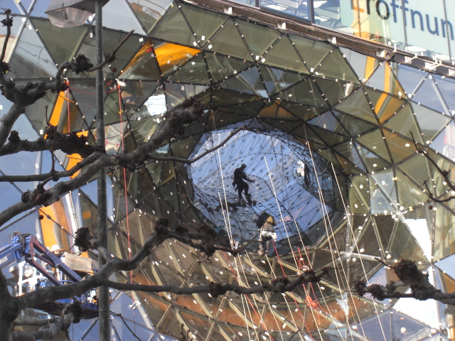 Last preparations done by glass-climbing workers