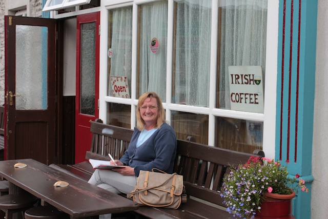 Maria with journal in Ireland